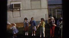 1962: few small girls playing some game & dancing & singing on some song. Stock Footage