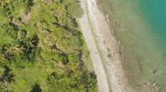 Curve winding road along the coast of the Philippines. Aerial views Stock Footage