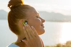 Fitness girl with wireless headphones Stock Photos