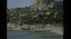 1962: a strange double exposure of various people and a rocky coastline IZMIR Stock Footage