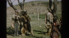 1962: a man talking and showcasing a bear which he maybe wanting to sell  Stock Footage