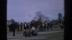 1962: a fight game of camels is point of attraction for everyone who is there  Stock Footage