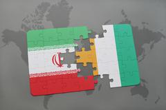Puzzle with the national flag of iran and cote divoire on a world map backgro Stock Photos