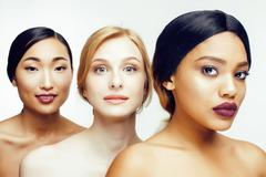 Three different nation woman: asian, african-american, caucasian together Stock Photos