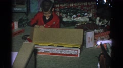 1962: young boy opening christmas present GARY INDIANA Stock Footage