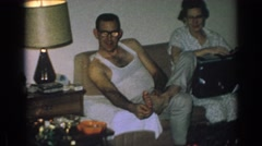 1962: family sits in living room smiling and talking to each other GARY INDIANA Stock Footage