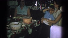 1962: family members gather around a table to enjoy food GARY INDIANA Stock Footage