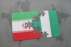 Puzzle with the national flag of iran and nigeria on a world map background. Kuvituskuvat