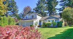 Beautiful curb appeal. Gray siding house on a sunny day. Northwest, USA Stock Photos