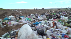 Plastic bags and junk on a huge landfill Stock Footage