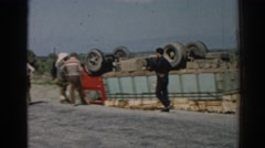 1962: truck accident crashed flipped over on roadside inspected by men Stock Footage