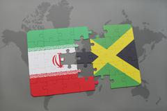 Puzzle with the national flag of iran and jamaica on a world map background. Kuvituskuvat