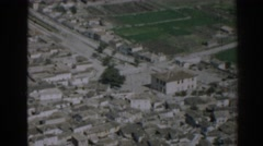1962: view from a high area of a planted plain and a small village IZMIR TURKEY Stock Footage