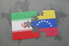 Puzzle with the national flag of iran and venezuela on a world map background Stock Photos
