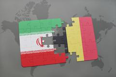 Puzzle with the national flag of iran and belgium on a world map background. Stock Photos