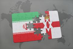Puzzle with the national flag of iran and northern ireland on a world map bac Stock Photos