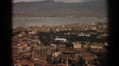 1962: zooming in upon a quiet town by a lake IZMIR TURKEY Stock Footage