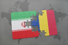 Puzzle with the national flag of iran and romania on a world map background. Stock Photos