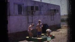 1962: little kids playing outside with their dog. IZMIR TURKEY Stock Footage