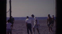 1962: businessman cajoled into playing beach volleyball. IZMIR TURKEY Stock Footage