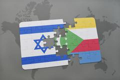 Puzzle with the national flag of israel and comoros on a world map background Stock Photos