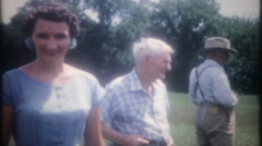 Family gathers in the frontyard for reunion photos 3733 vintage film home movie Stock Footage