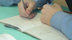 Pupil decides the task in a notebook in math Stock Footage