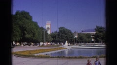 1962: children sitting in a park in front of a large pool of water IZMIR TURKEY Stock Footage