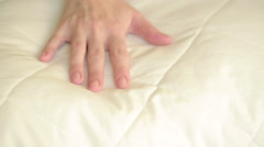 Female hand pressing on the pillow. soft pillow Stock Footage