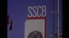 1962: lonely biker rides bicycle outside of mysterious sscb building. IZMIR Stock Footage