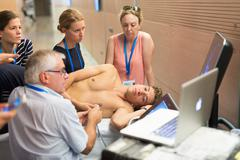 Participants learning new ultrasound techniques on medical congress. Stock Photos