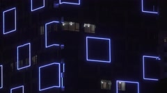 Christmas LED lights adorns the facade of the high-rise building Stock Footage