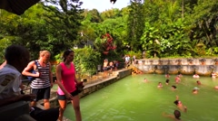 Air Panas Banjar hot springs. Tourists and local people swimming in hot springs. Stock Footage