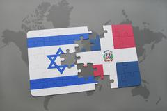 Puzzle with the national flag of israel and dominican republic on a world map Kuvituskuvat