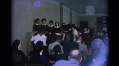 1962: nuns gathered in room listening to aspiring nuns kids singing IZMIR TURKEY Stock Footage