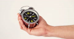 Man hand holding alarm clock Stock Footage