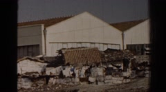 1962: two huge storage like structure of building maybe some working place too Stock Footage