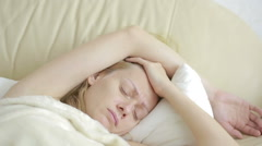 Sick woman lying on the bed. pills and glass of water. drink tablets. painkiller Stock Footage