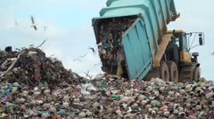 Large truck dumps waste on a landfill Stock Footage