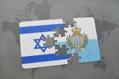 Puzzle with the national flag of israel and san marino on a world map backgro Stock Photos