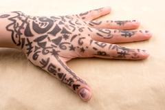 Hand with tattoo Stock Photos