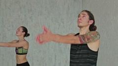 Sporty man and woman doing ashtanga yoga Stock Footage