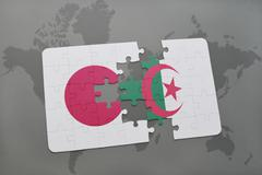 Puzzle with the national flag of japan and algeria on a world map background. Stock Photos