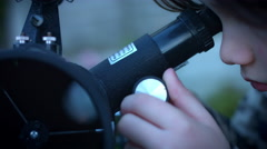 4k Technology and Astrology Child with Binoculars and Telescope, close-up Stock Footage