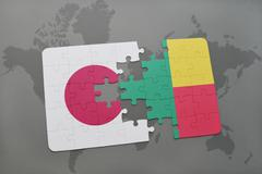 Puzzle with the national flag of japan and benin on a world map background. Stock Photos