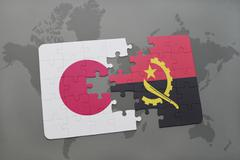 Puzzle with the national flag of japan and angola on a world map background. Stock Photos
