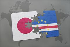 Puzzle with the national flag of japan and cape verde on a world map backgrou Stock Photos