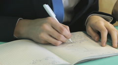 Student decides the task in a notebook in math Stock Footage
