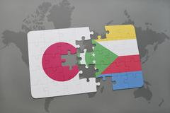 Puzzle with the national flag of japan and comoros on a world map background. Stock Photos