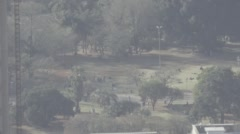 Timelapse of people in a park in Johannesburg Stock Footage